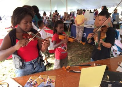 Photo of attendees at the Musical Instrument Petting Zoo at Sen Pat Browne Expo