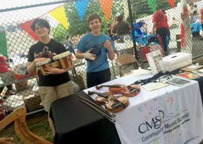 Children posing with instruments at the Musical Instrument Petting Zoo at Central Elementary, Allentown