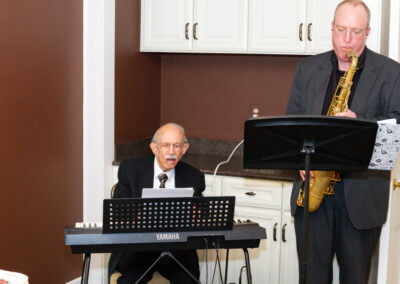 Dr. David Saturen and Ian Cunningham perform at the CMS Spring Brunch