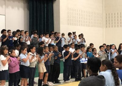 Photo of children performing in the Roosevelt Elementary Flutophone Concert with Elaine Martin