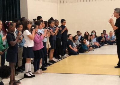 Photo of kids performing in the Roosevelt Elementary Flutophone Concert with Elaine Martin