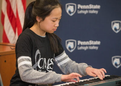 A student performs on piano during the Lehigh Valley Arts Council's Young at Art Expo